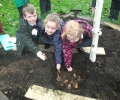 Planting at our memorial tree