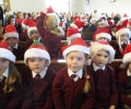 Junior pupils pray with Santa